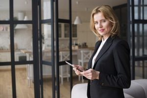 blond-business-woman-using-tablet