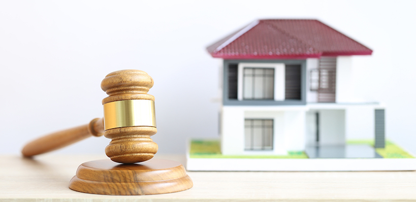 Property auction, Gavel wooden and model house on wtite background, lawyer of home real estate and ownership property concept