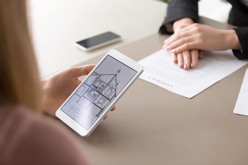 Close up of house plan on tablet, real estate contract