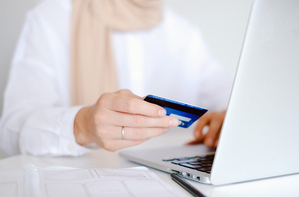 person-in-white-long-sleeve-shirt-holding-credit-card